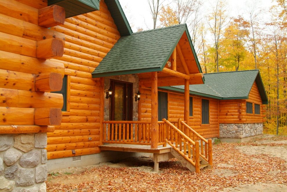 Woodhaven Lumber for a Rustic Exterior with a Log Siding and Cedar Half Log Siding by Woodhaven Log & Lumber