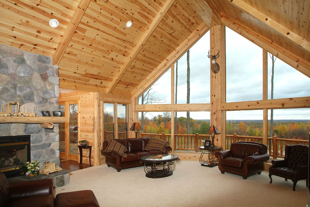 Woodhaven Lumber for a Rustic Living Room with a Log Siding and Knotty Pine Tongue and Groove Paneling Great Room by Woodhaven Log & Lumber