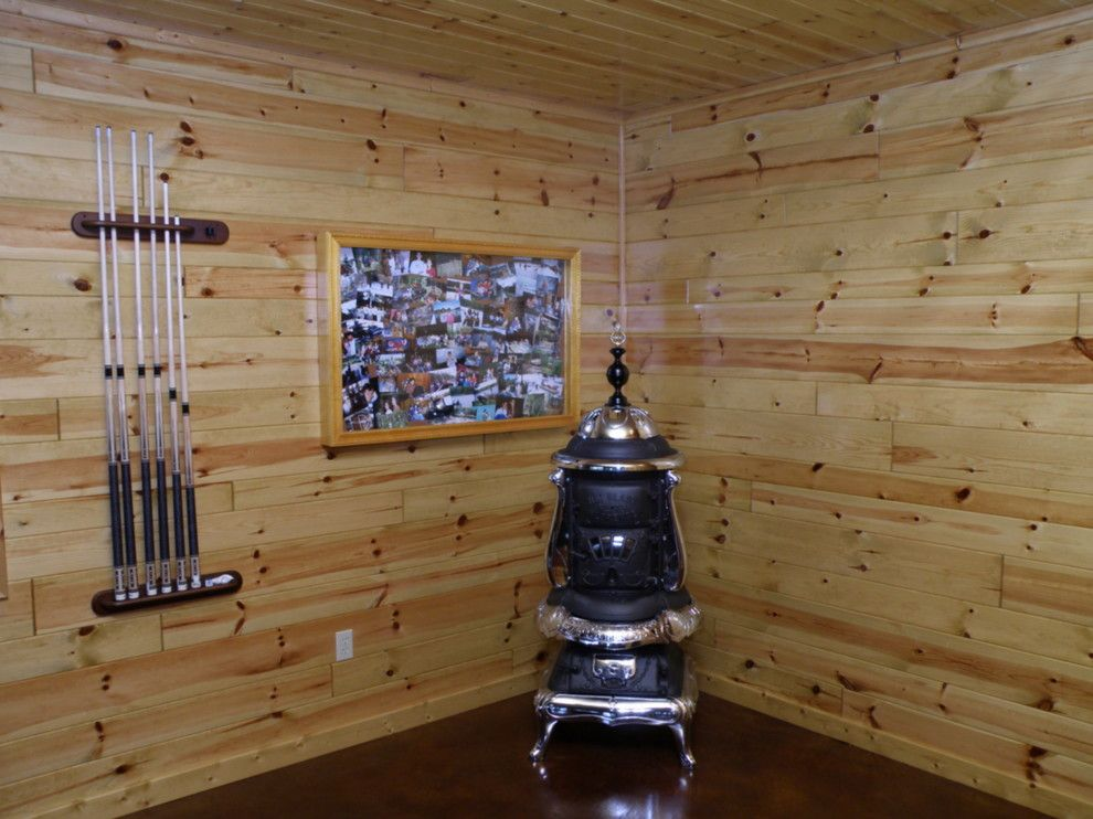Woodhaven Lumber for a Rustic Spaces with a Knotty Pine Paneling and Knotty Pine Paneling Man Cave by Woodhaven Log & Lumber
