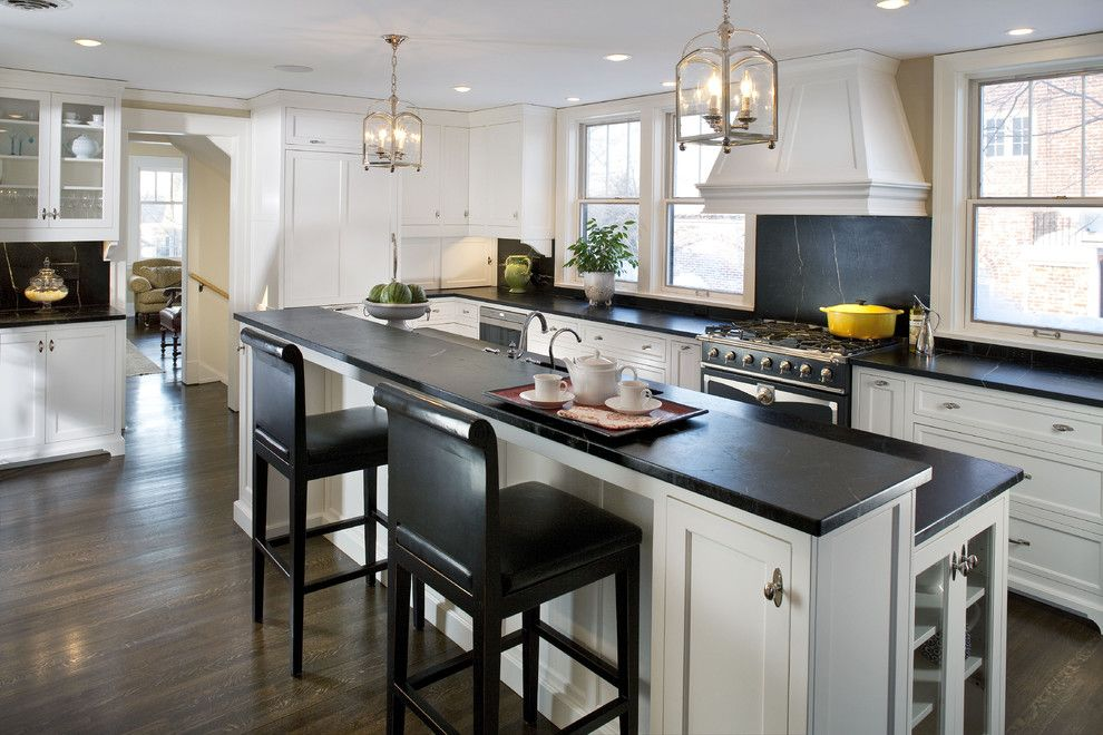 Woodshop Ideas for a Traditional Kitchen with a Stone Backsplash and the Woodshop of Avon by the Woodshop of Avon