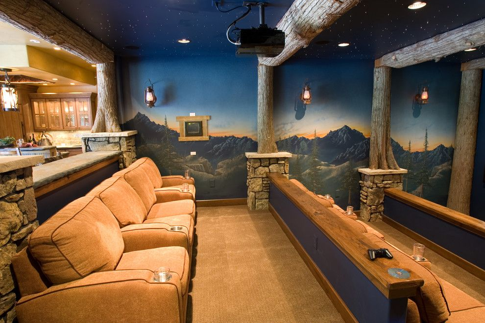 Wormald Homes for a Rustic Home Theater with a Tiered and Glass Forest Summit County by Designworks Development