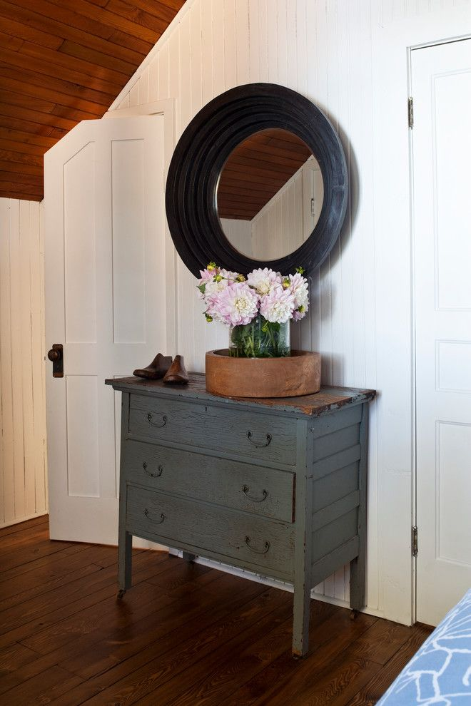 Worts for a  Spaces with a Wood Ceiling Cottage and Cottages by Jennifer Worts Design Inc.