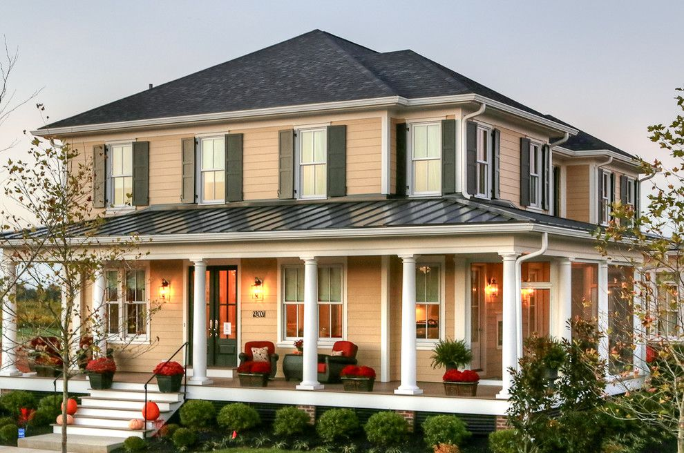 Wrap around porch house plans for a farmhouse porch with a for Traditional exterior home designs