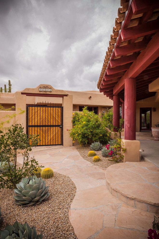 Xeriscape for a Southwestern Landscape with a Adobe Walls and Cave Creek Home in Arizona by Azul Verde Design Group, Inc.