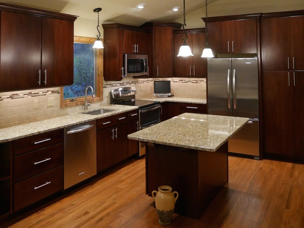 Yorktowne Cabinets for a Modern Kitchen with a Stainless Steel Stove and Asbury Kitchen by HOME SOLUTIONS