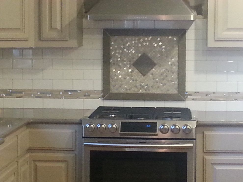 Zodiaq Quartz for a  Spaces with a Zodiaq Quartz Coarse Pepper with a Subway Tile with Quartz F and Zodiaq Quartz with Custom Tile Backsplash by Waters'  Specialty Countertops Inc.