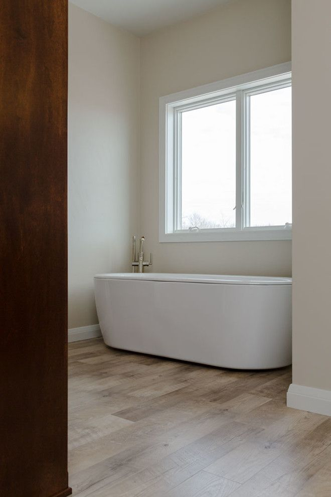 Adura for a  Bathroom with a White Trim and Shabby Chic Ranch by Hj Martin & Son