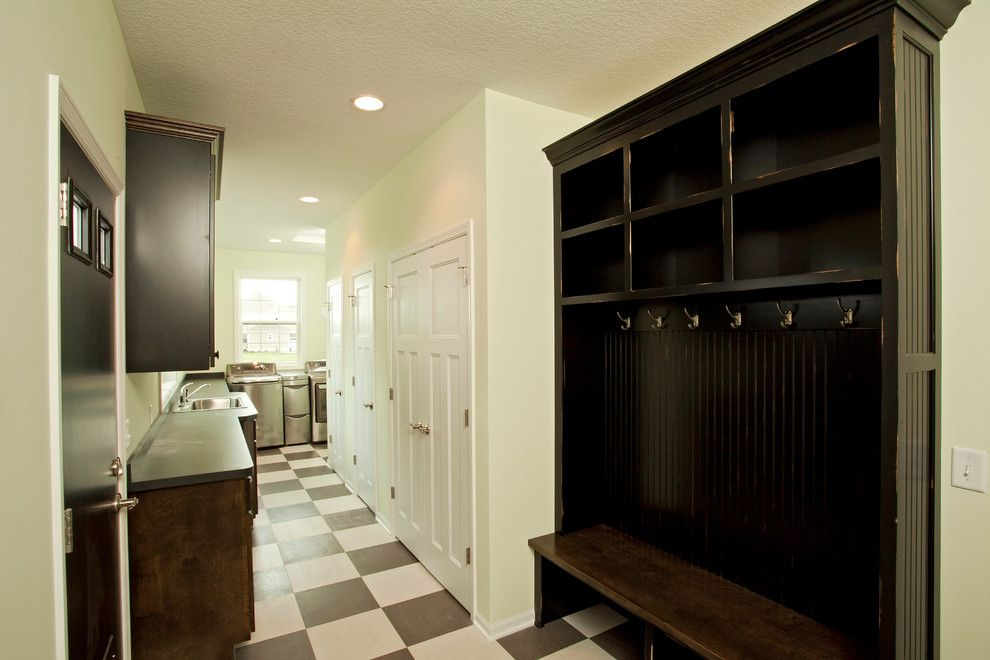Adura for a  Entry with a Laundry and Armstrong Home - Lakeville by Homes by Tradition