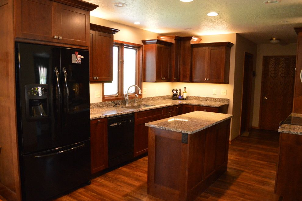 Adura for a Traditional Kitchen with a Custom Made Cherry Cabinetry and Custom Cherry  Kitchen Remodel by Oak Tree Homes