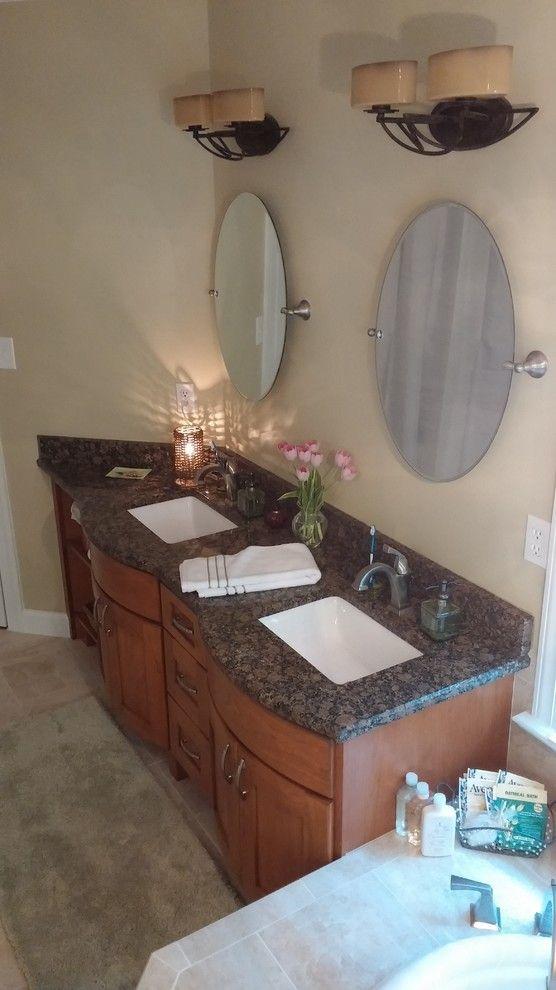 Apex Plumbing for a Traditional Bathroom with a Cary and Verrilli by Designhouse Kitchen and Bath, Llc