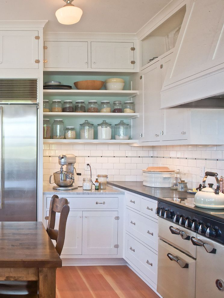 Ballard Hardware for a Traditional Kitchen with a White Kitchen and Ballard Farmhouse by Seattle Custom Cabinets