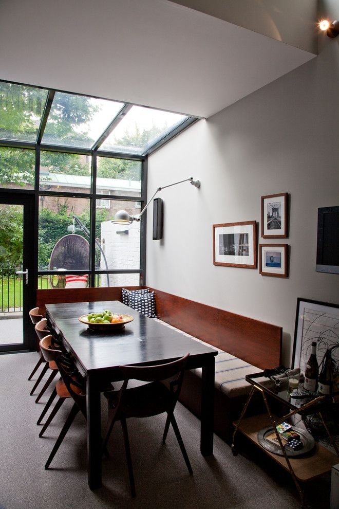 Bendheim Glass for a Contemporary Dining Room with a Banquette Seating and Clarendon Road by Sigmar