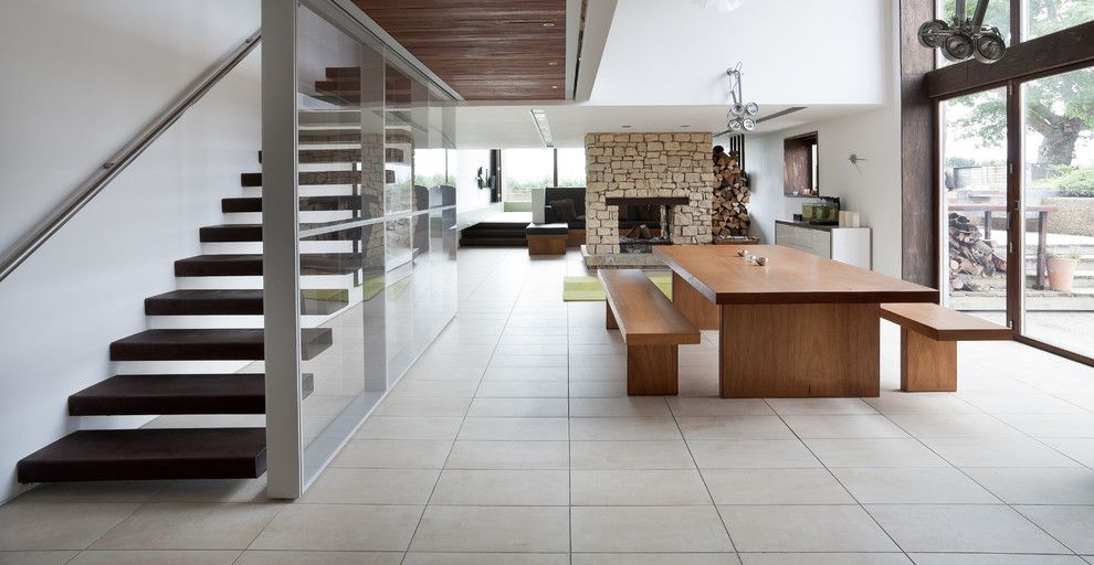 Bendheim Glass for a Contemporary Kitchen with a Glass Panel Staircase and the Long Barn by Nicolas Tye Architects