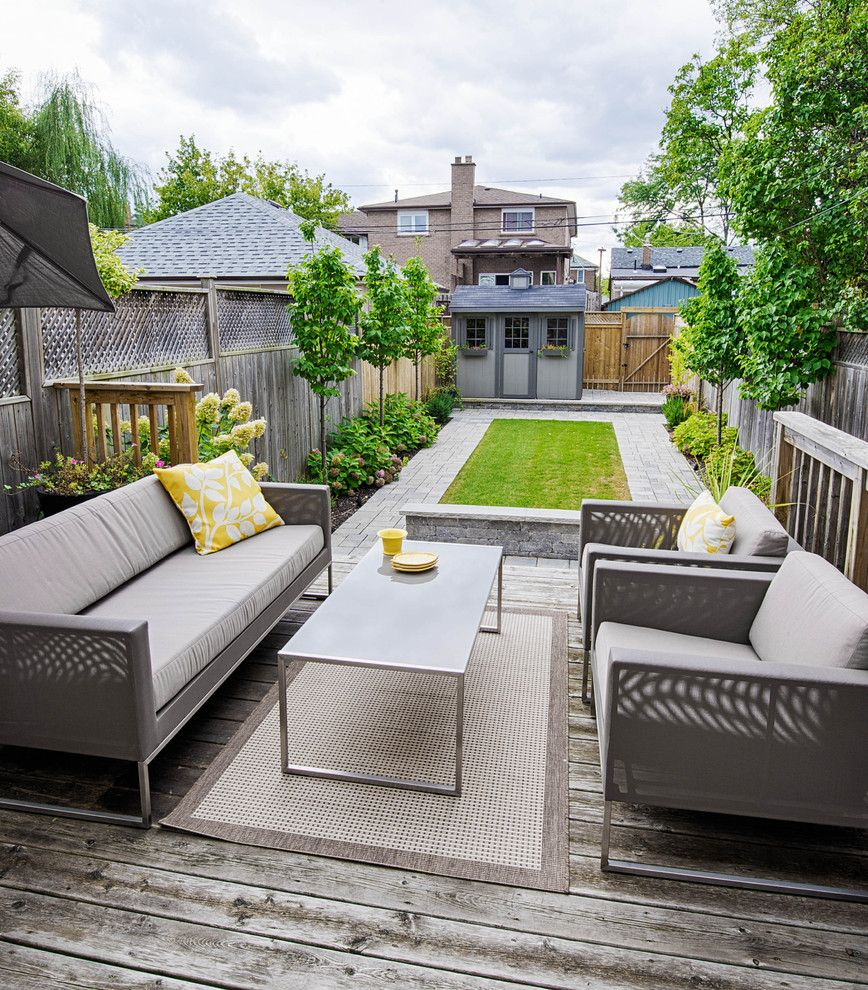 Casa Leaders Furniture for a Transitional Deck with a Foundation Planting and Toronto House by Affecting Spaces