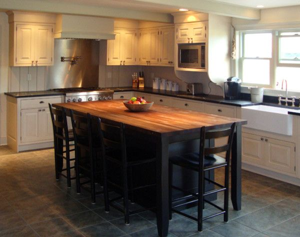 Cinder Block Wall for a Traditional Kitchen with a Kitchen Island and Vintage Farmhouse by Columbia Cabinets