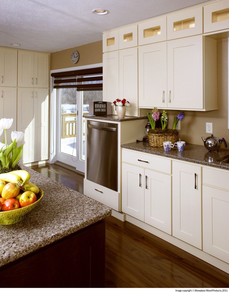 Cleaning Dishwasher with Vinegar for a Traditional Kitchen with a Island and Showplace Cabinets   Kitchen by Showplace Wood Products