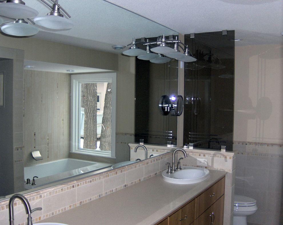 Conaway Homes for a Contemporary Spaces with a Frameless and Conaway Home Guest Bath by Ford Metro Inc