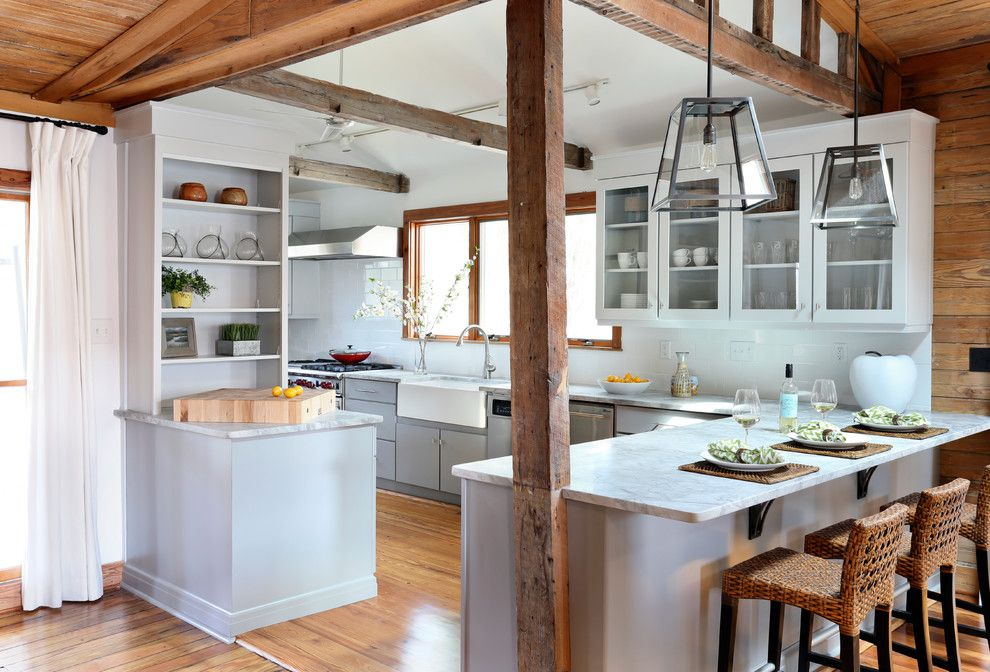 Conestoga Wood Specialties for a Beach Style Kitchen with a Wicker Chair and Amy Trowman Design   Beach Houses by Matthew Bolt Graphic Design