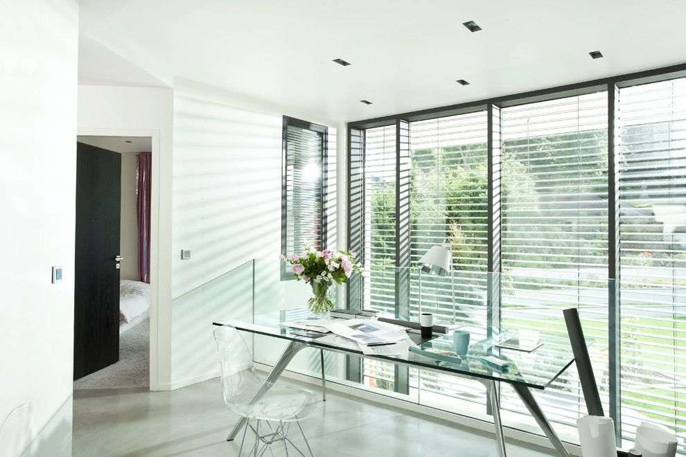 Dow Furniture for a Modern Home Office with a Glass Railing and Somfy by Somfy