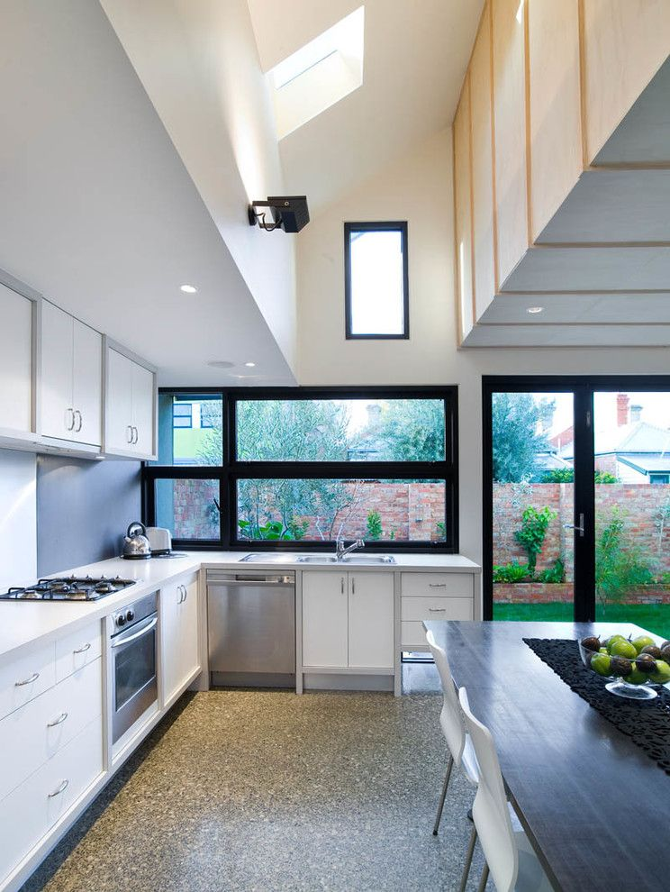 Exposed Aggregate Concrete for a Contemporary Kitchen with a Recessed Lighting and Fitzroy Renovation and Extension by Architecture Matters Pty. Ltd.