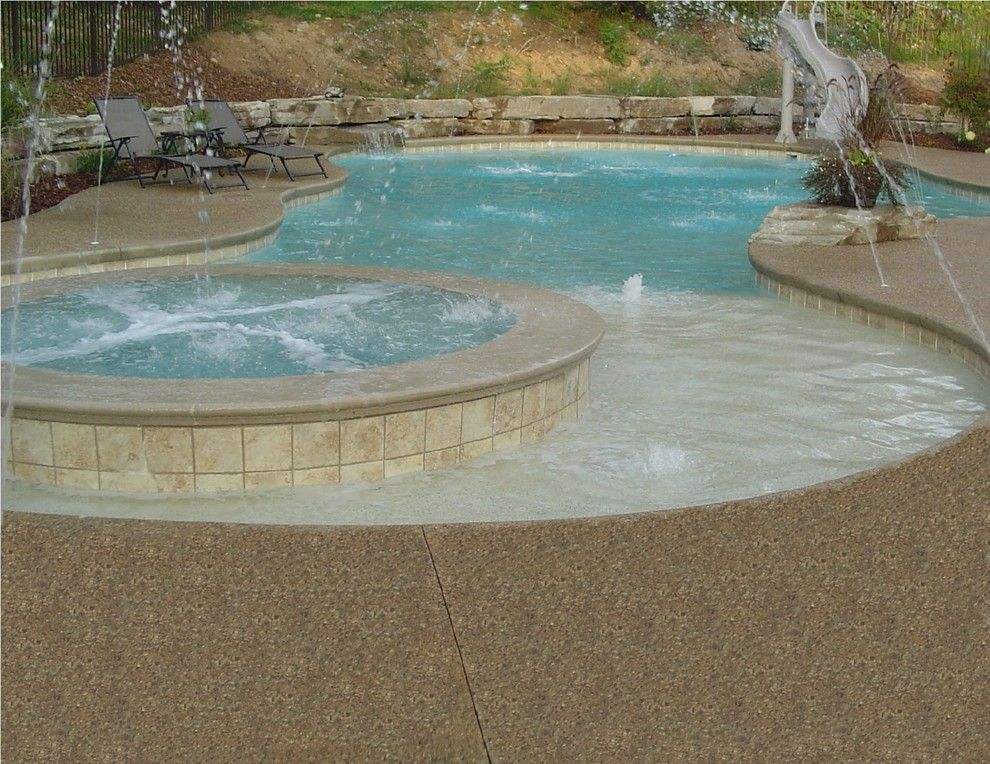 Exposed Aggregate Concrete for a Tropical Pool with a Pool Deck Ideas and Inground Swimming Pool Deck Around Gunite Pool in White Lake by Potoroka Concrete Decorative Surfaces
