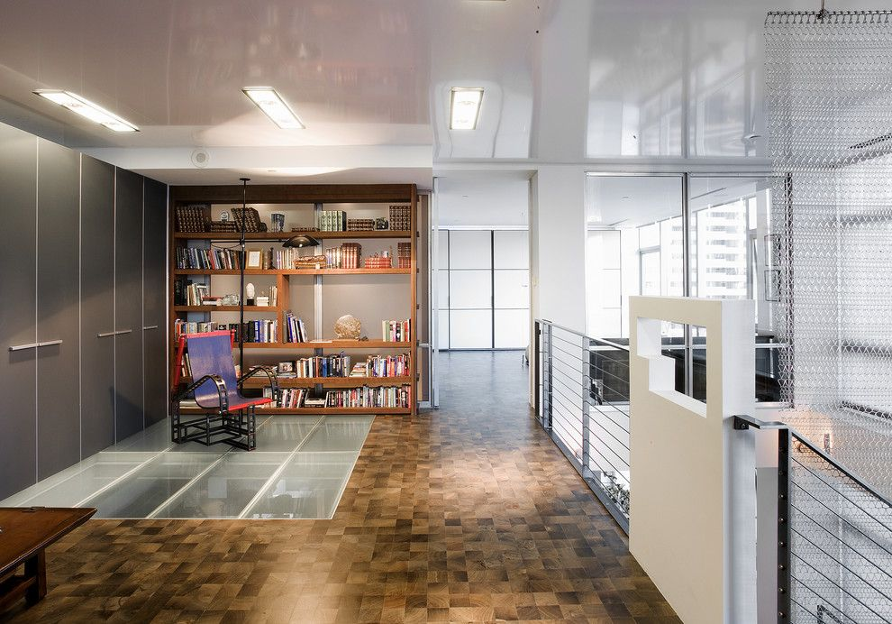 Factory Direct Okc for a Contemporary Home Office with a Studio and Millennium Tower Loft Home Office by Musadesign Interior Design