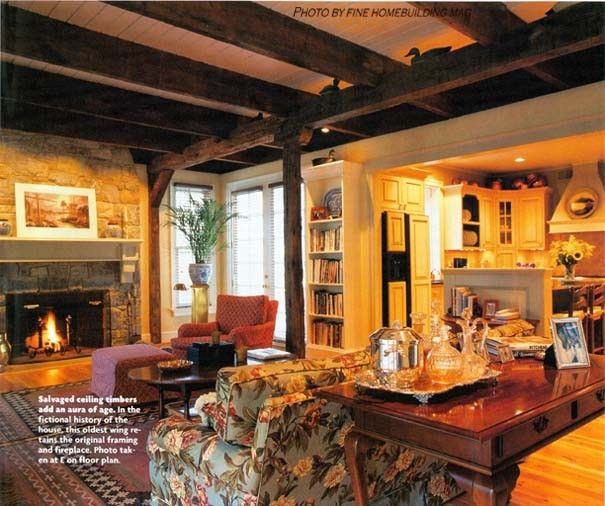 Finehomebuilding for a Traditional Living Room with a Stone Fireplace and Living Space Under Exposed Timber Ceilings Finehomebuildingmag by Kevin Mckenna Architects