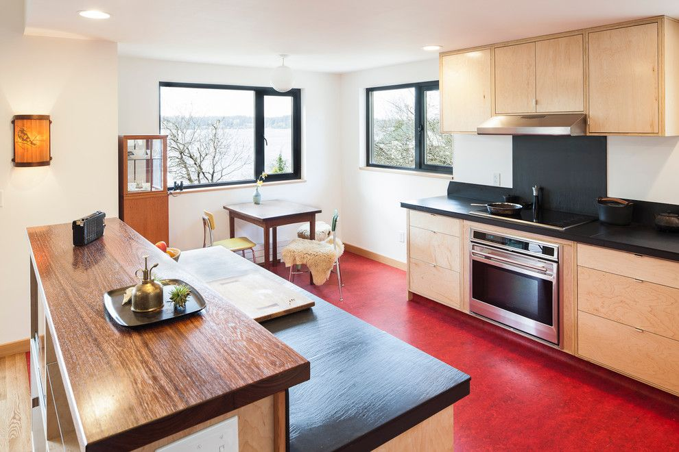 Forbo Flooring for a Modern Kitchen with a Yellow Chair and Modern Foursquare by Bicycle Homebuilding Company