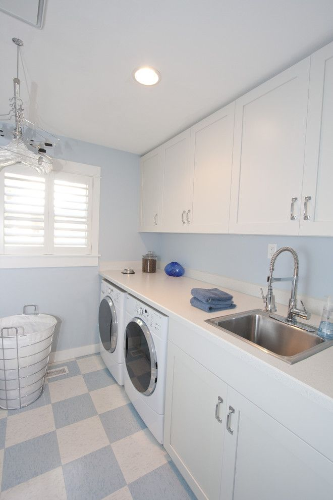Forbo Flooring for a Traditional Laundry Room with a Harlequin Floor Pattern and Bright and Airy Whole House Remodel by the Neil Kelly Company