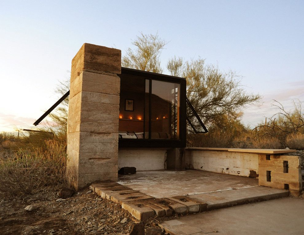 Frank Lloyd Wright Phoenix for a Eclectic Exterior with a Concrete Wall and the Miner's Shelter by Broken Arrow Workshop