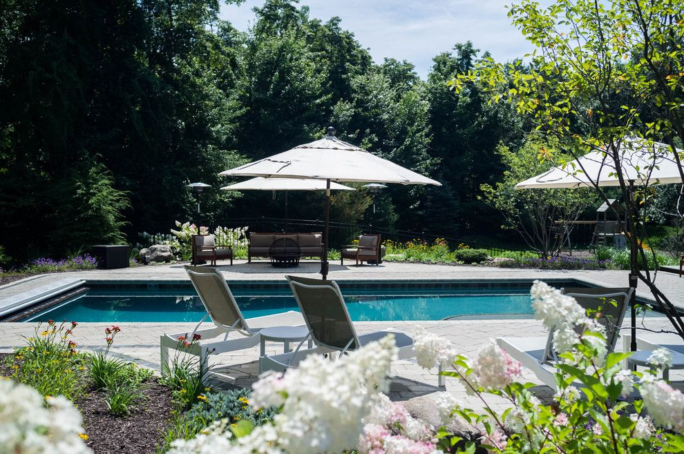 Haworth Holland Mi for a Traditional Pool with a Waterfall and Holland Residence by MeadowGreen Group