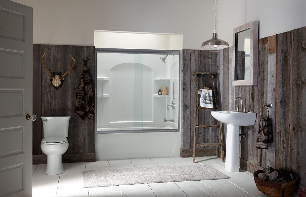 How Much Does a Spray Tan Cost for a Rustic Bathroom with a Reclaimed Wood Walls and Bathroom by Sterling Plumbing