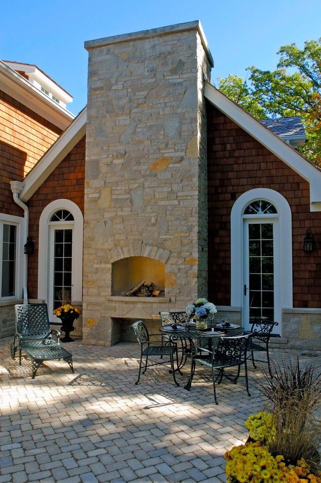 How to Build a Paver Patio for a Traditional Patio with a Arched Window and Nantucket Stone and Shingle Style Elegance in Lake Forest by Orren Pickell Building Group