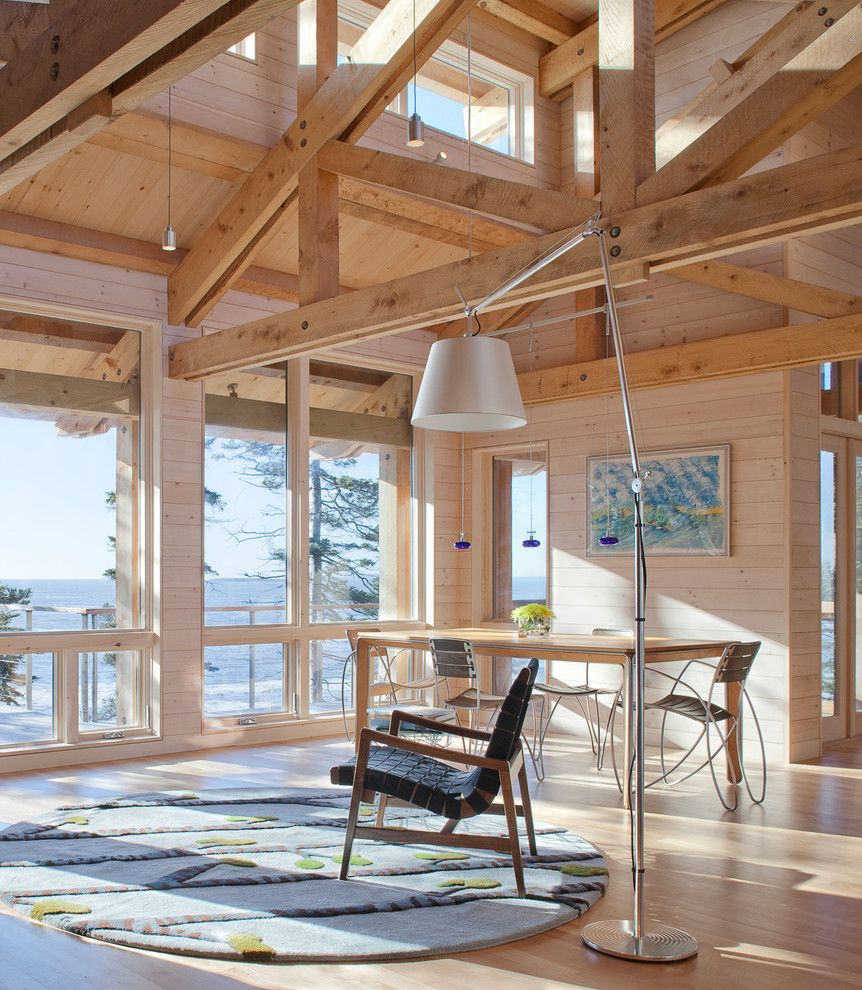How to Whitewash Furniture for a Rustic Living Room with a Open Ceiling and Living and Dining by Whitten Architects