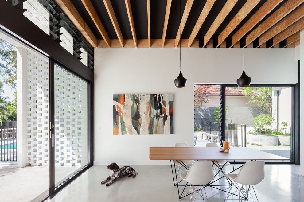 Jalousies for a Contemporary Dining Room with a Abstract Art and Hood House by Steele Associates