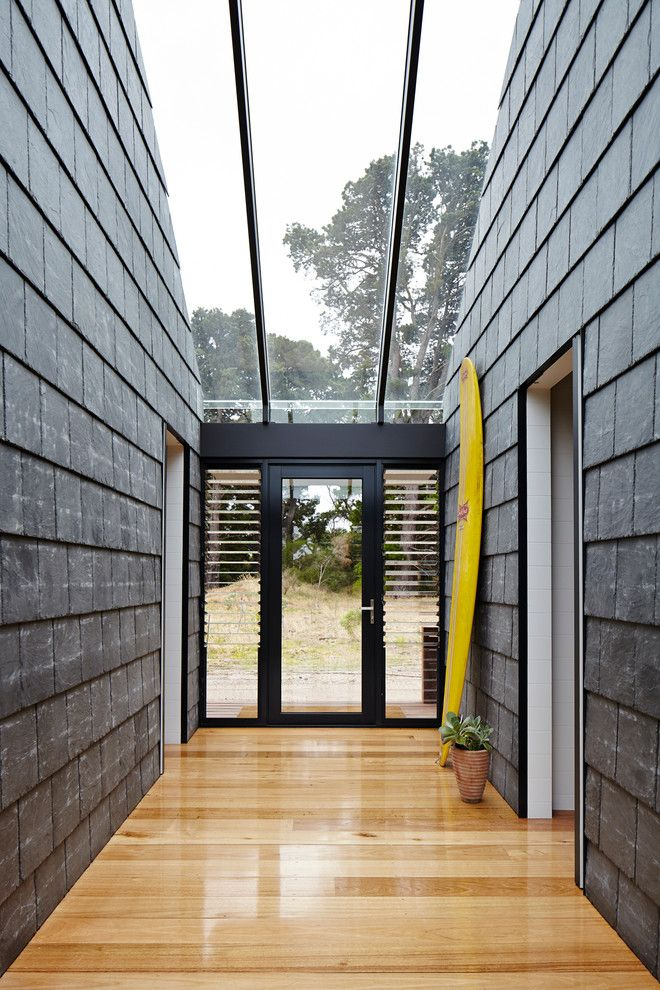 Jalousies for a Contemporary Entry with a Skylight and Wallington Residence by Schored Projects