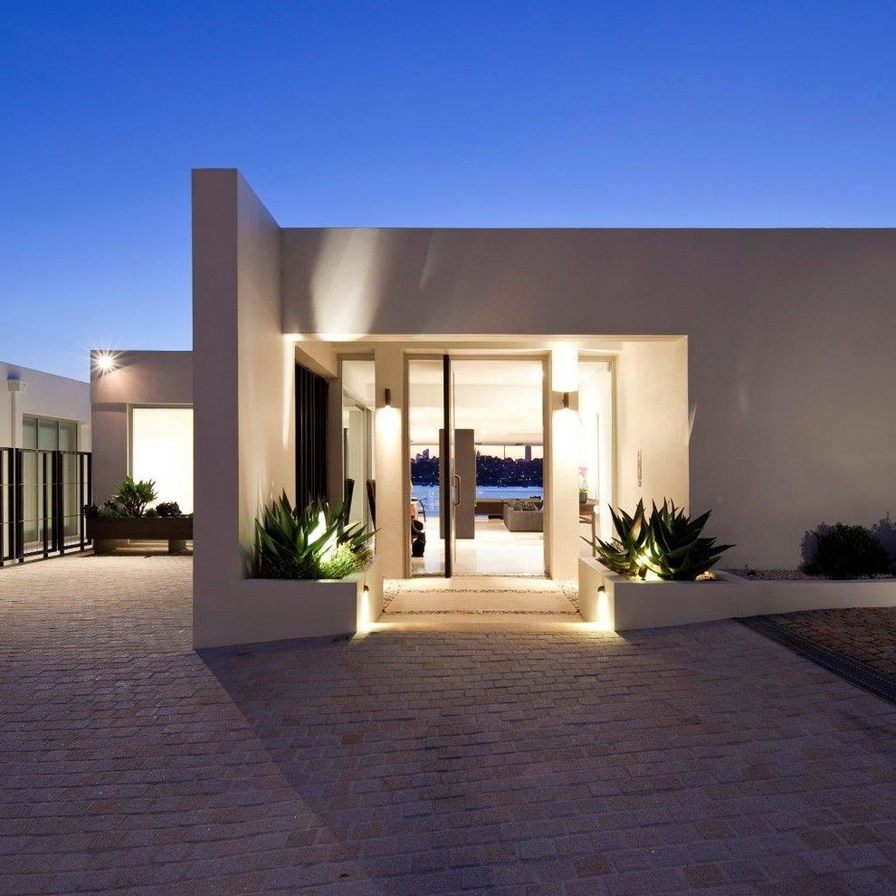 Klinker Brick for a Modern Entry with a Beige Exterior and Rose Bay Residence I by Horizon Habitats