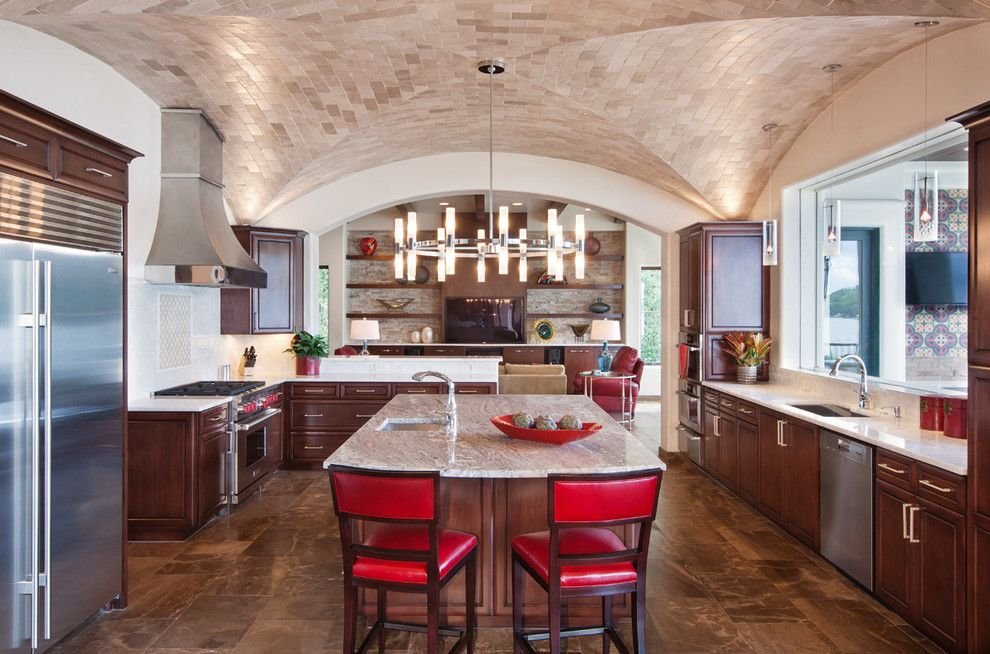 Lakeside Appliance for a Mediterranean Kitchen with a Stainless Steel Hood and Lakeside Spanish Colonial by Austin Design Group