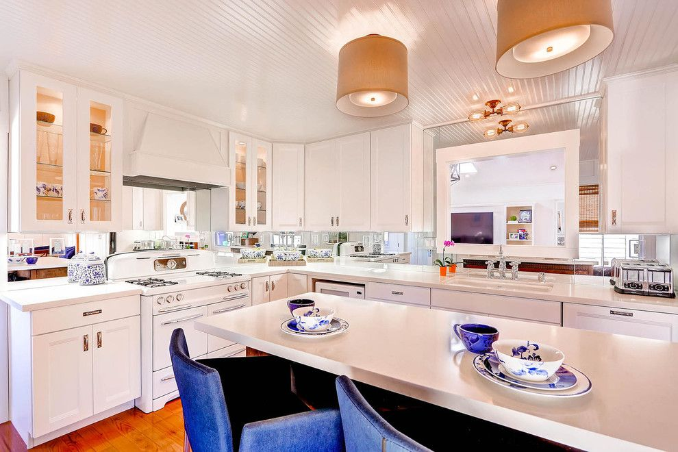 Lakeside Appliance for a Transitional Kitchen with a Mirror Backsplash and Lakeside Remodel by Carnik Residential Design