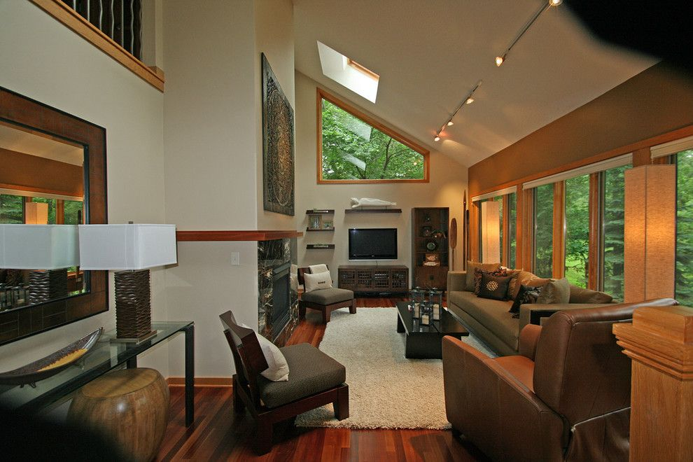 Lazar Furniture for a Asian Family Room with a Accent Wall and Woodbury Home by Happy Interiors Group