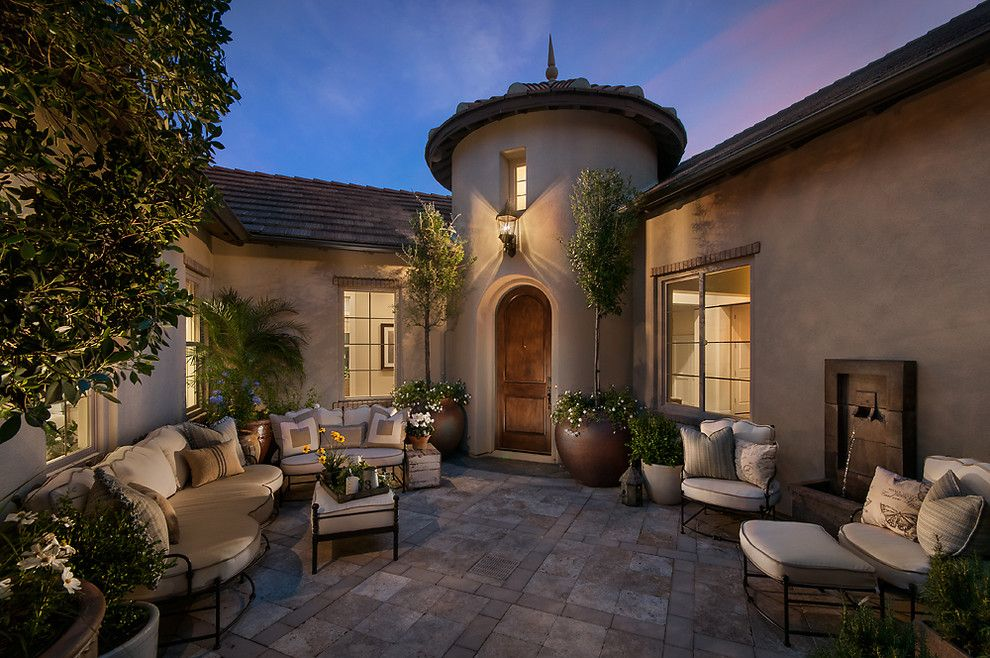 Lazar Furniture for a Mediterranean Patio with a Finial and Camelot Reserve by Camelot Homes