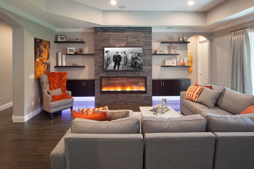 Lazar Furniture for a Transitional Family Room with a Built in Fireplace and Sherbourne Circle by Morrone Interiors