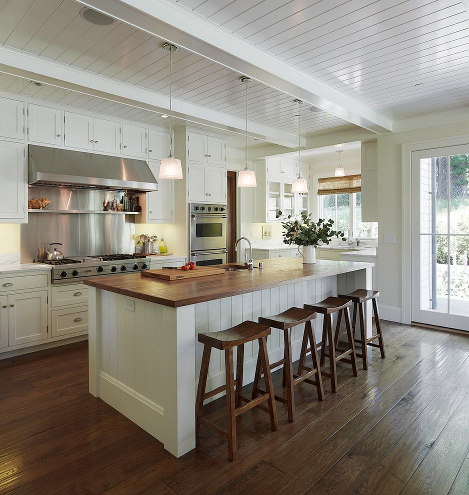 Long Island Paneling for a Traditional Kitchen with a Dark Floor and Residence in California by Taylor Lombardo Architects