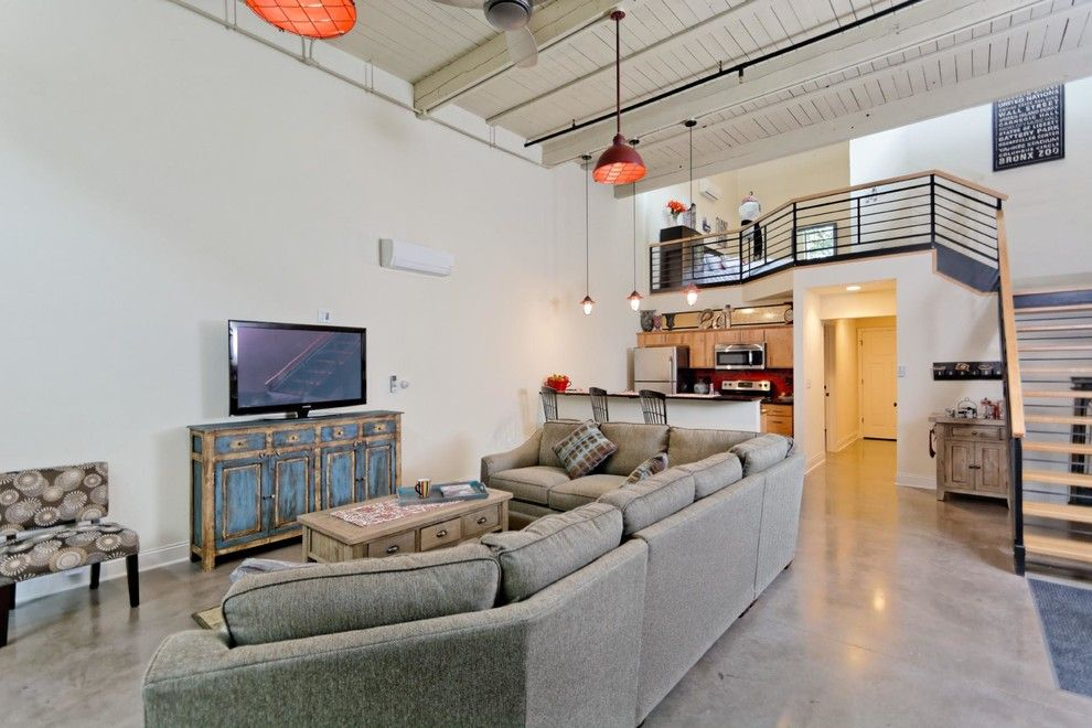 Lyndon Furniture for a Industrial Living Room with a Concrete Flooring and Window Factory Lofts by Viscusi Builders Ltd.