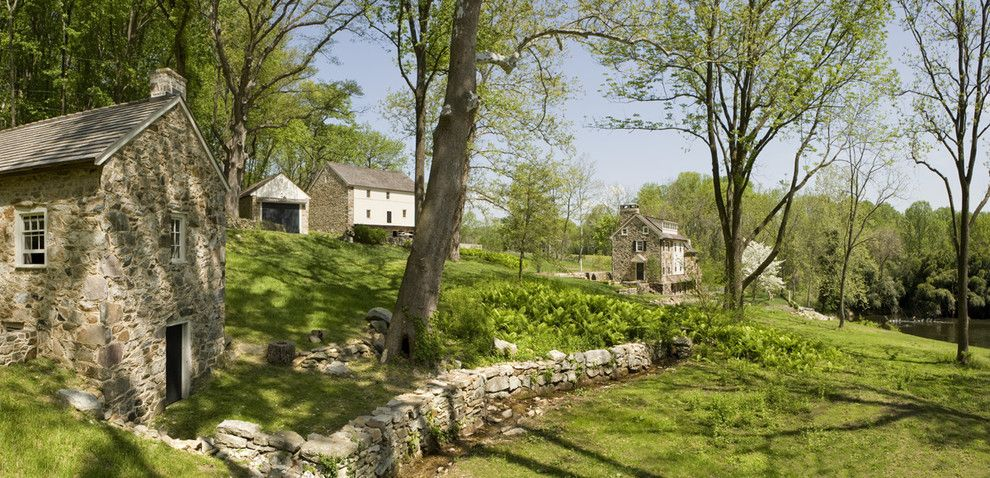 Maple Lawn Farms for a Rustic Landscape with a Stone Barn Barn and Mine Road Farm - Exterior by Archer & Buchanan Architecture, Ltd.