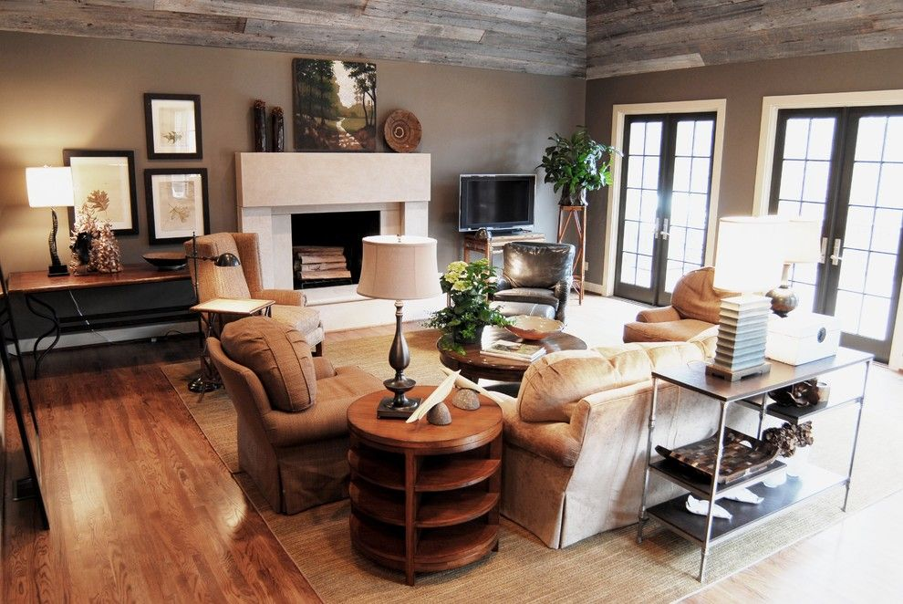 Martin Senour Paints for a Traditional Family Room with a Stone Fireplace and Cozy Family Room W/reclaimed Barn Siding Ceiling by Studio C Architecture & Interiors