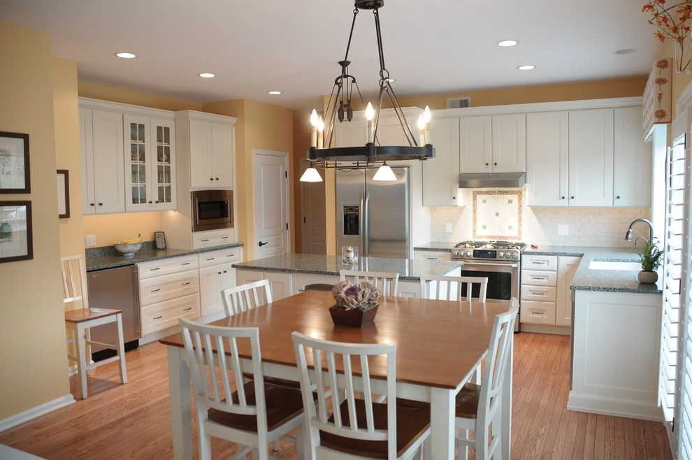Martin Senour Paints for a Traditional Kitchen with a Wood Floor and Kitchen Remodel in West Chester, Pa by Pine Street Carpenters & the Kitchen Studio