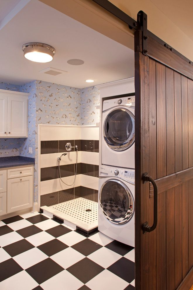 Midwest Homes for Pets for a Traditional Laundry Room with a Stacked Washer and Dryer and Classic Lake Cottage with a Modern Twist by Ridge Creek Custom Homes