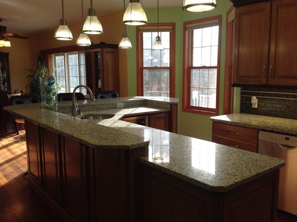 Mobern Lighting for a Eclectic Kitchen with a Large Island and Vetrazzo Island by Avalon Kitchen