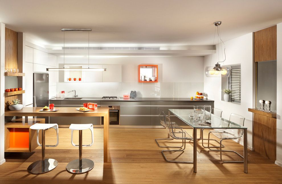 Mobern Lighting for a Modern Kitchen with a Orange and Kitchen by Elad Gonen